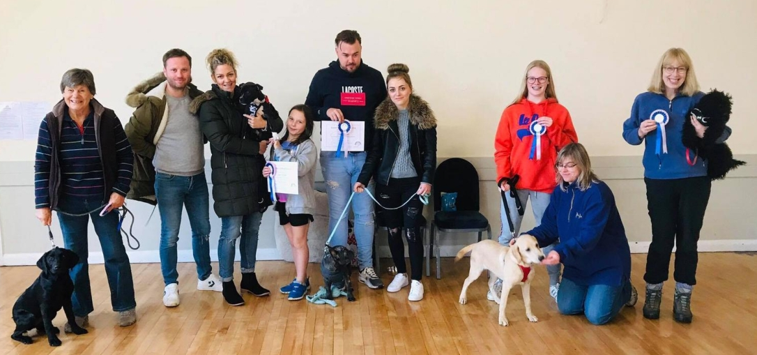 dogs and their owners graduating from Puppy School at Ace Tails